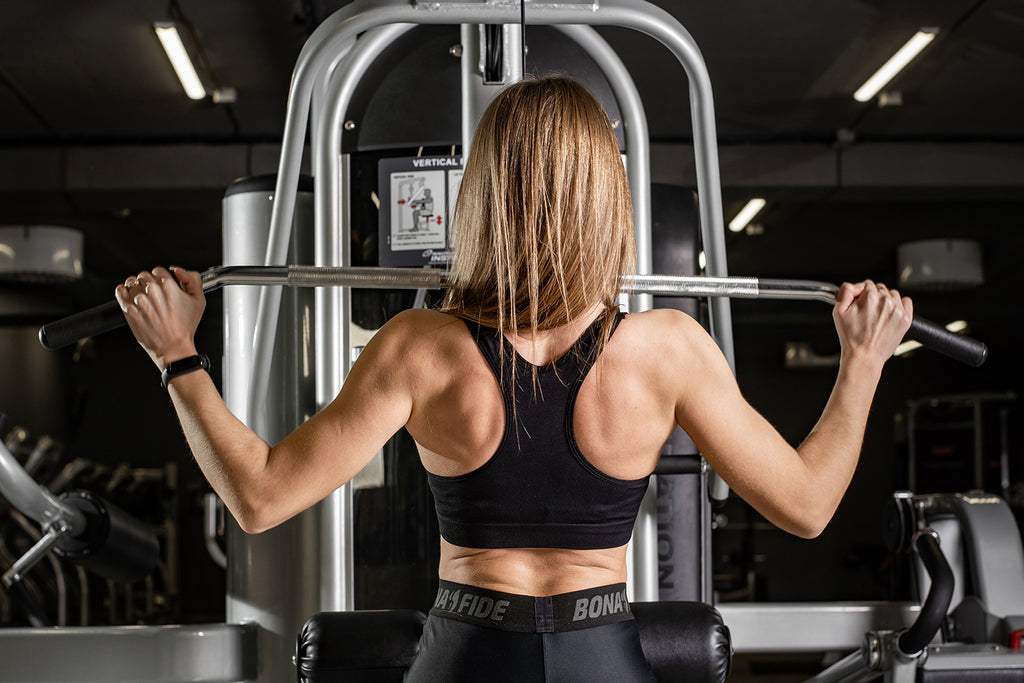 Woman doing a chest and back workout