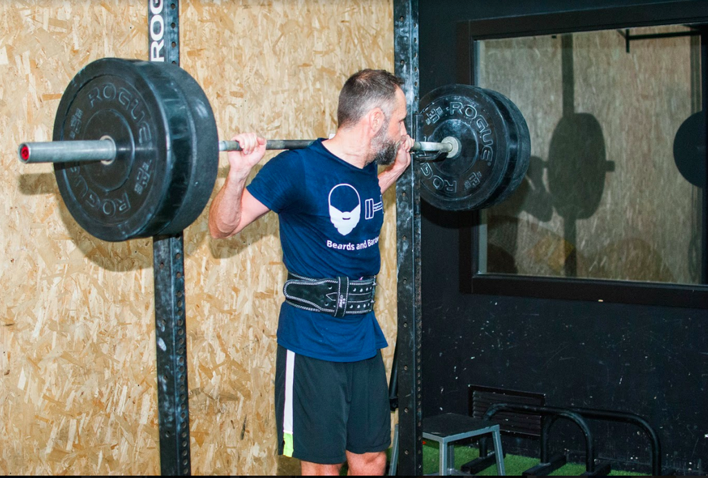 What is resistance training: Man doing weights