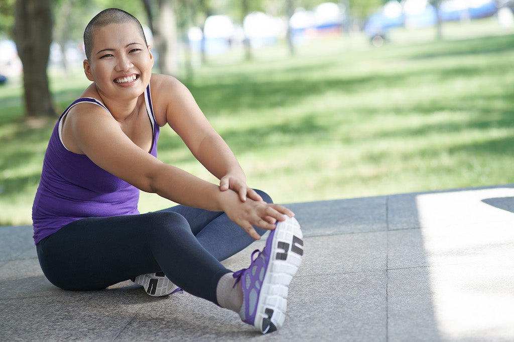 girl smiling while stretching