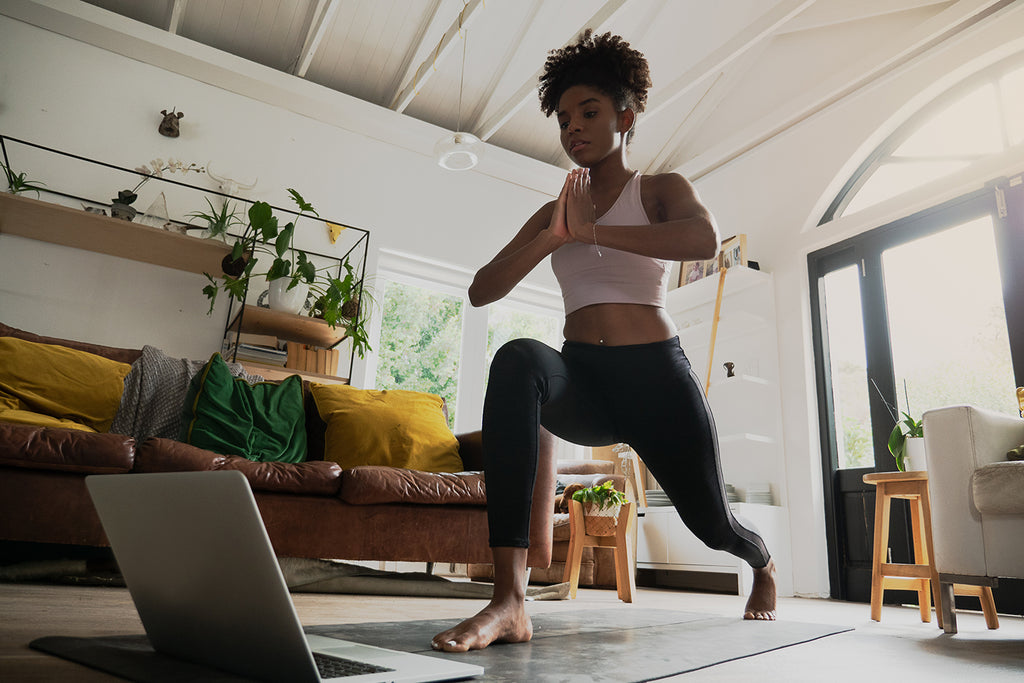 Woman doing a runner's lunge as part of her stretches for knee pain