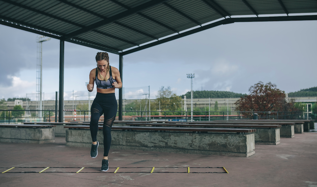 health related fitness: woman doing ladder drills