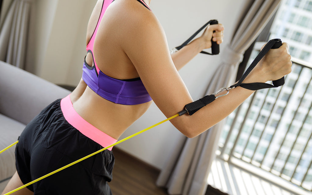 Woman doing an upper body workout at home