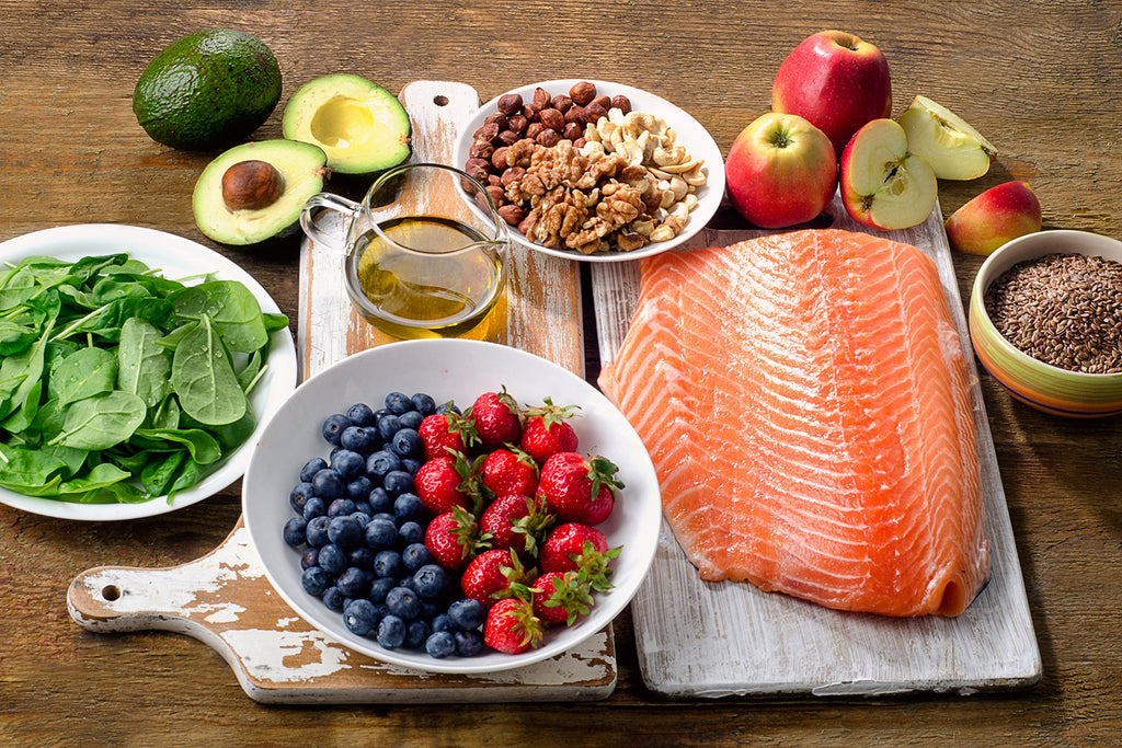 Collection of salmon, fruits, vegetables, nuts, and oils