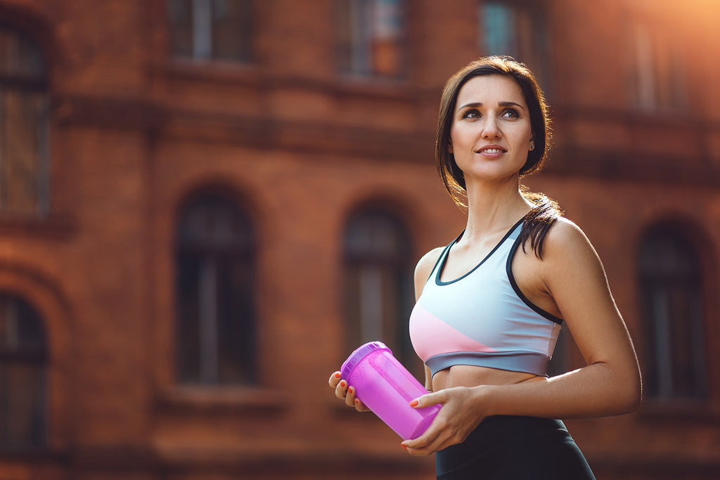 creatine benefits: girl carrying electorlytes jag while excercising outdoor