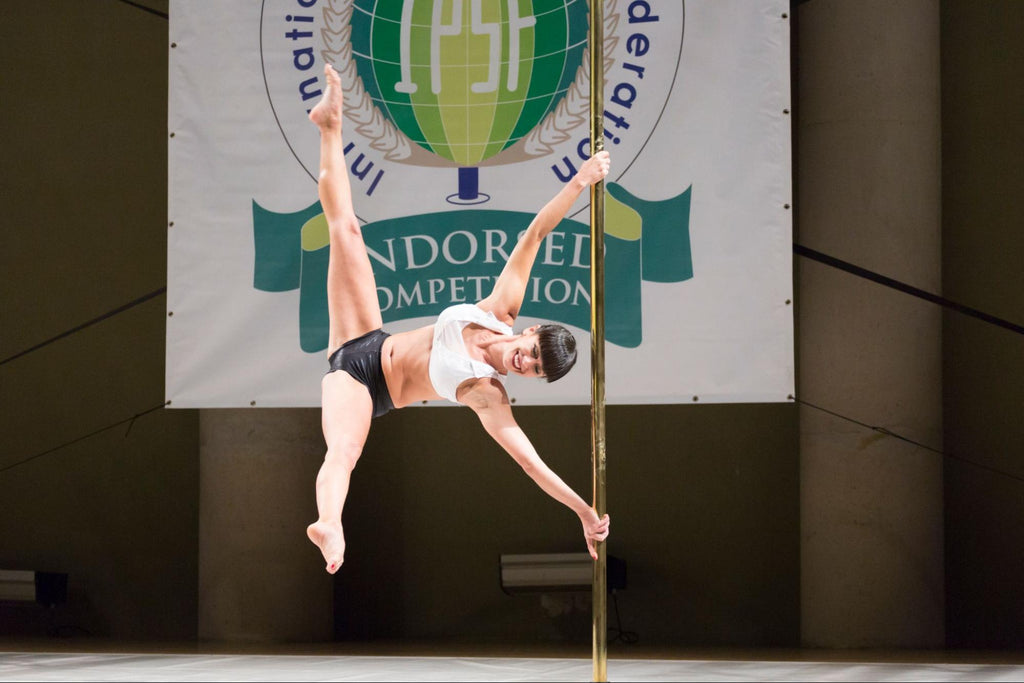 pole fitness: woman participating at a pole dancing competition