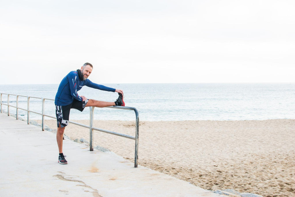 when do overuse or overtraining injuries occur?: man stretching his legs outside