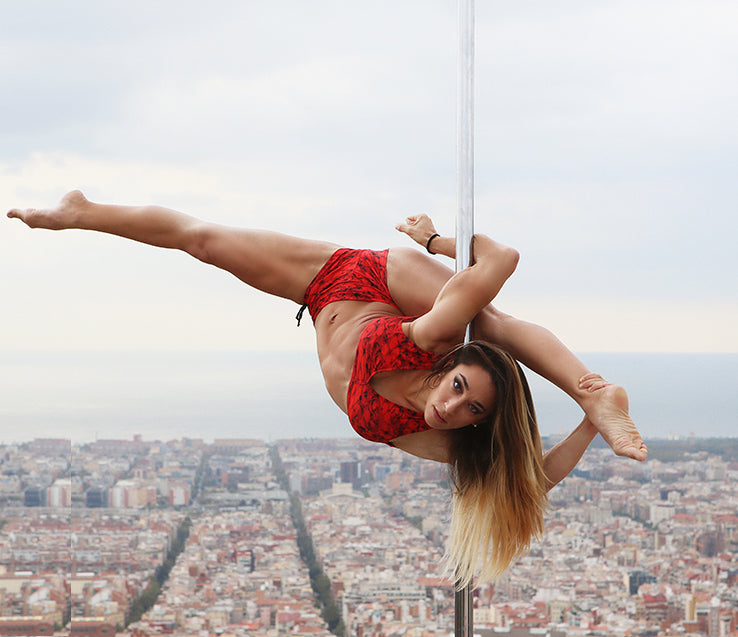 pole fitness: woman pole dancing outdoors