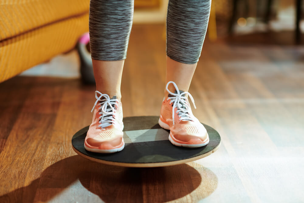 person standing on a balance board