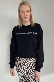 STOLEN GIRLFRIENDS CLUB TEXT LOGO CREW SWEAT - BLACK/BLACK  The Stolen Girlfriends Club Text Logo Crew Sweat is a great staple crew for the cooler seasons, as its a classic throw-on style and features signature 'Stolen Girlfriends Club' pastille printed logo across the chest, finished with thick ribbed sleeve cuffs and hemline. Simple, stylish, versatile and comfortable. Crafted from cotton, the Text Logo Crew Sweat is guaranteed to keep you cosy while looking cool.