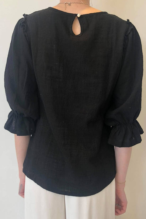 BLAK ALL MY HEART TOP - BLACK  The Blak All My Heart Top is a simple 3/4 sleeve top perfect for daily wear. The All My Heart Top features a crew neckline, with billowing sleeves, elasticated sleeve cuffs sporting a single frill, finished with ruffled shoulders and a subtly curved hemline.
