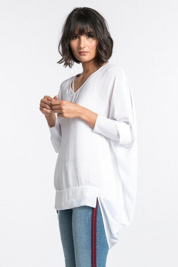 NES VERTUE TUNIC - INK  The Nes Vertue Tunic is a sheer flowy top versatile top that can be layered or worn alone. The Nes Vertue Tunic features a soft v neckline, batwing style 3/4 elongated cuffed sleeves and a long draped rear hemline.    - Sizes- S, M, L - Polyester - V neckline - Elasticated cuffed sleeves - Batwing style sleeves