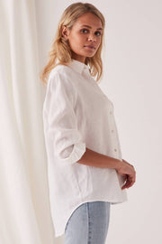 ASSEMBLY LABEL XANDER SHIRT  The Assembly Label Xander Shirt is back, and now available in Black, or White. The Xander Shirt is a gorgeous wardrobe staple, perfect for dressing up or down! The Xander Shirt is relaxed fitting, crafted from soft linen, and features a classic button up front, a classic collar, and adjustable button cuffed sleeves, finishing with a gently curved hemline dropping slightly lower at the back.
