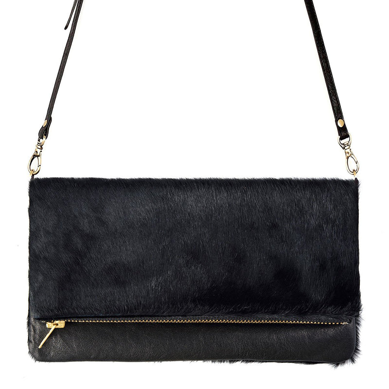 Status Anxiety Gwyneth Bag -Black / Black Fur Womens Handbag / Premium Italian leather and printed cowhide / Large open pocket for the main compartment / Zipper area under the front flap for all your cards and cash / Detachable long strap (to use as a clutch) / 26.5cm (wide) x 15cm (high when folded) or 26.5cm (high when opened flat) / Comes in a Status Anxiety soft material drawstring bag