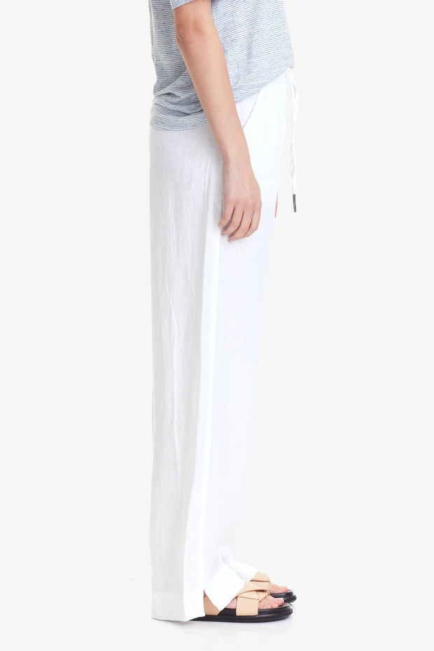 COMMONERS WIDE LEG LINEN PANT  The Commoners Wide Leg Linen Pants are the perfect basic wardrobe staple, now available in a crisp white. The Wide Leg Linen Pants speak for themselves and feature a relaxed silhouette, with wide legs sitting approximately at the ankle, finishing with an encapsulated elasticated waistband with drawstrings for controlled comfort. Crafted using a soft linen blend,