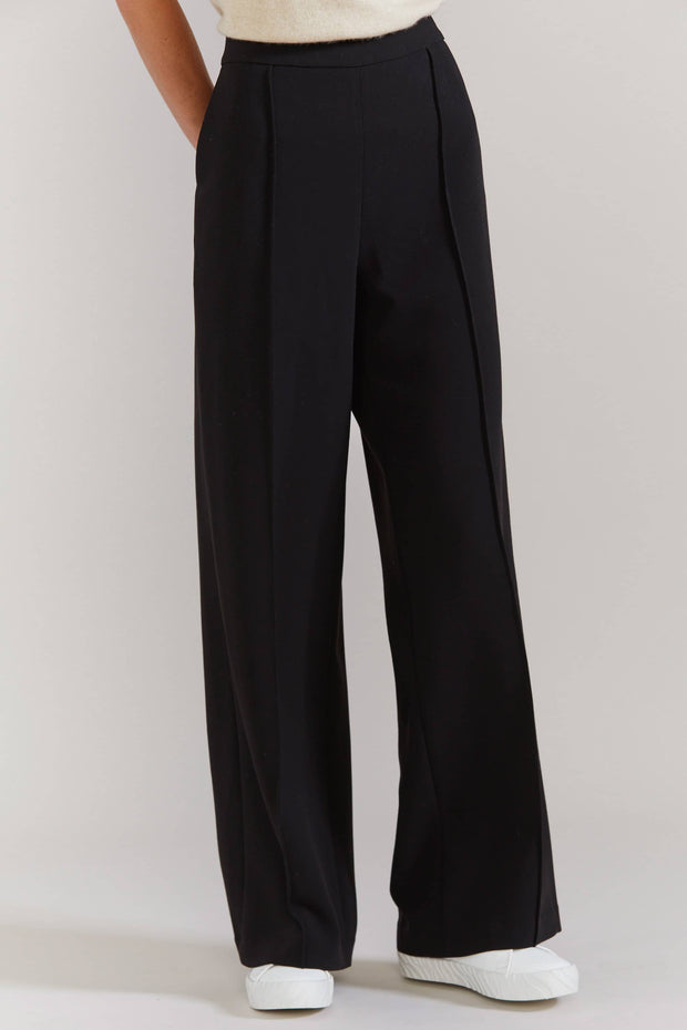 LAING CHAPLAIN PULL ON PANT - BLACK  The Laing Chaplain Pull On Pants speak for themselves! They are a 'pull-on' style pants which feature an elasticated half band at the back of the waistline, with a flat front, moving to open straight falling wide legs, finished with straight-cut hemlines. Simple sophistication at its finest.