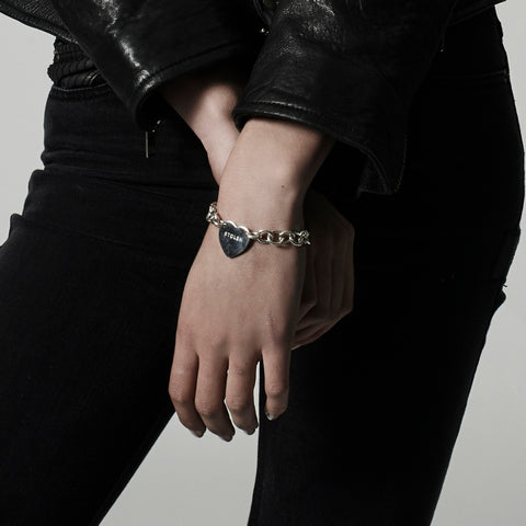 Stolen Girlfriends Club Cold Heart Bracelet The Stolen Girlfriends Club Cold Heart Bracelet is an edgy chain-style bracelet. Featuring a chunky chain with a large heart in the centre with the 'Stolen' logo. The bracelet has an adjustable length due to its clasp closure.