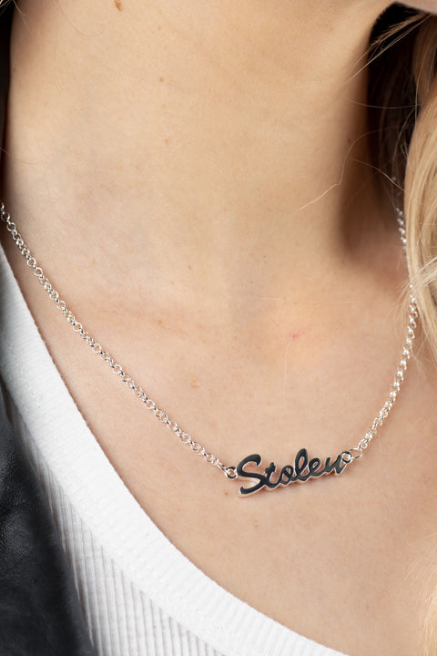 STOLEN GIRLFRIENDS CLUB STOLEN SCRIPT NECKLACE  The Stolen Girlfriends Club Stolen Script Necklace is a simple feminine necklace perfect for daily wear. The Script necklace features a fine chain with 'Stolen' written in a linked cursive font, finished with a classic clasp closure. Simple sophistication at its finest. Wear the Stolen Girlfriends Club Stolen Script Necklace daily or for your chosen occasion.