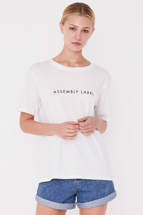 ASSEMBLY LABEL LOGO COTTON CREW TEE  The Assembly Label Logo Cotton Crew Tee is a classic slogan tee perfect for every day wear. The Assembly Label Logo Cotton Crew Tee features a relaxed silhouette and crew neckline, finishing with signature 'Assembly Label' across the chest. Crafted using cotton, this tee is light and breathable. Team it back with your favourite shorts and sandals for an effortless casual look.