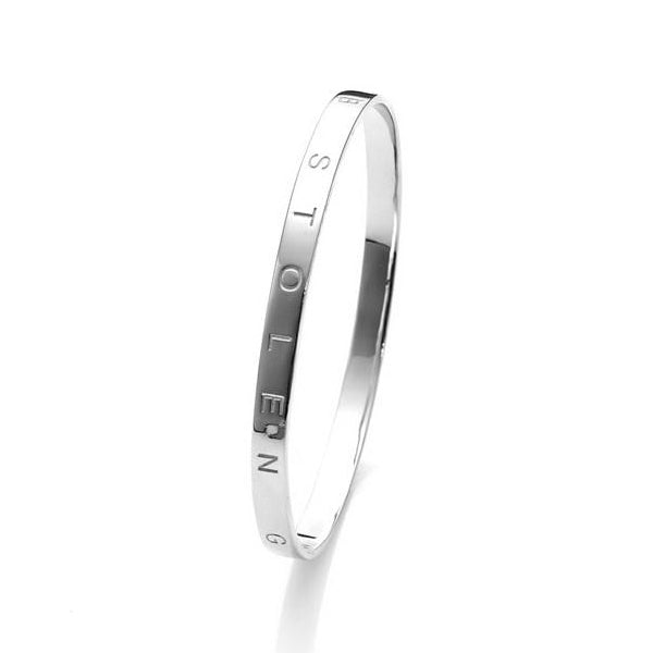 Stolen Girlfriends Club Stolen Bangle The Stolen Girlfriends Club Stolen Bangle is an updated version of the classic silver bangle. Crafted in high polish sterling silver this bangle is thick with 'Stolen Girlfriends Club' engraved on the bangle.