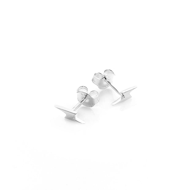 Stolen Girlfriends Club I'll Be Lightening Earrings Stolen Girlfriends Club I'll Be Lightening Earrings are crafted from high polish sterling silver, and are sold as a pair. These little lightening studs are perfect for everyday wear. Wear them solo or mix and match!