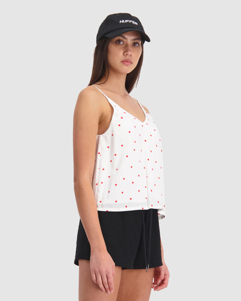 HUFFER PICNIC ADA CAMI - WHITE/ RED  The Huffer Picnic Ada Cami is a simple yet fun cami perfect for summer. The Huffer Picnic Ada Cami features a v-neck cut on both the front and back, adjustable straps, and is lined for extra comfort. This cami can be worn casually with a simple skirt or shorts, and your favourite sandals.  - Sizes- 6, 8, 10, 12, 14 - Adjustable straps - V-neck cut front and back - 100% Viscose - Lining- 100% Viscose