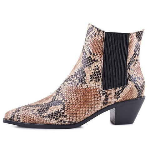 SOL SANA ROGER BOOT - SNAKE  The Sol Sana Roger Boot are an updated edgy take on the classic mule. The Roger Boot features a luxe soft snake printed leather outer, with black elasticated gussets for fitting comfort. The Sol Sana Roger Boots also feature a fun angled heel leading to an elongated pointed toe, which creates a flattering shape. These boots make the perfect pair of statement shoes for any outfit!