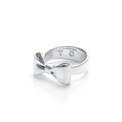 "STOLEN GIRLFRIENDS CLUB BOW RING  The Stolen Girlfriends Club Bow Ring is an iconic style favourite. The Club Bow Ring is crafted in high polish sterling silver, and features signature ""STOLEN' engraving inside the band. The Stolen Girlfriends Club Bow Ring has a thicker band, making it great to wear alone or stack in your style.  - Sterling silver - Comes in Stolen Girlfriends Club Jewellery box"