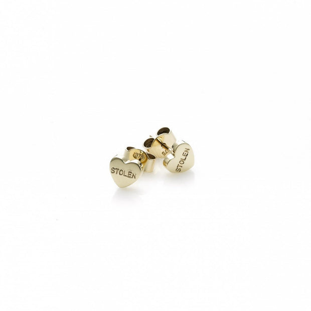 STOLEN GIRLFRIENDS CLUB STOLEN HEART EARRINGS  The Stolen Girlfriends Club Heart Earrings are cute mini heart studs, featuring the signature 'Stolen' Engraving on each heart, these little hearts are great for every day wear. Crafted using sterling silver, pair these with other studs or wear alone.