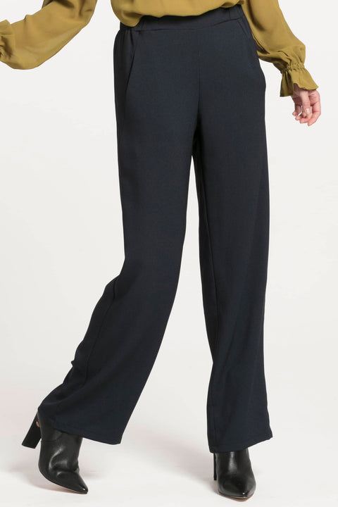 NES GIN PANT - BLACK  The Nes Gin Pants are the perfect staple wide leg pants great for work, casual, or occasion wear. The Gin Pants are a 'pull-on' style pants which feature an elasticated half band at the back and sides of the waistline, with a flat front, moving to open straight falling wide legs, finished with straight-cut hemlines.