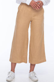 BLAK BENJI PANT  The Blak Benji Pants will be your new favourite wide leg pants for the changing seasons! The Benji Pant feature a gently gathered band across the front waistline, and elasticated back for ultimate comfort. They are wide leg at finish at a 7/8th length. The Blak Benji Pants are great for everyday wear or can easily be dressed up with a cami and heels for a night out.