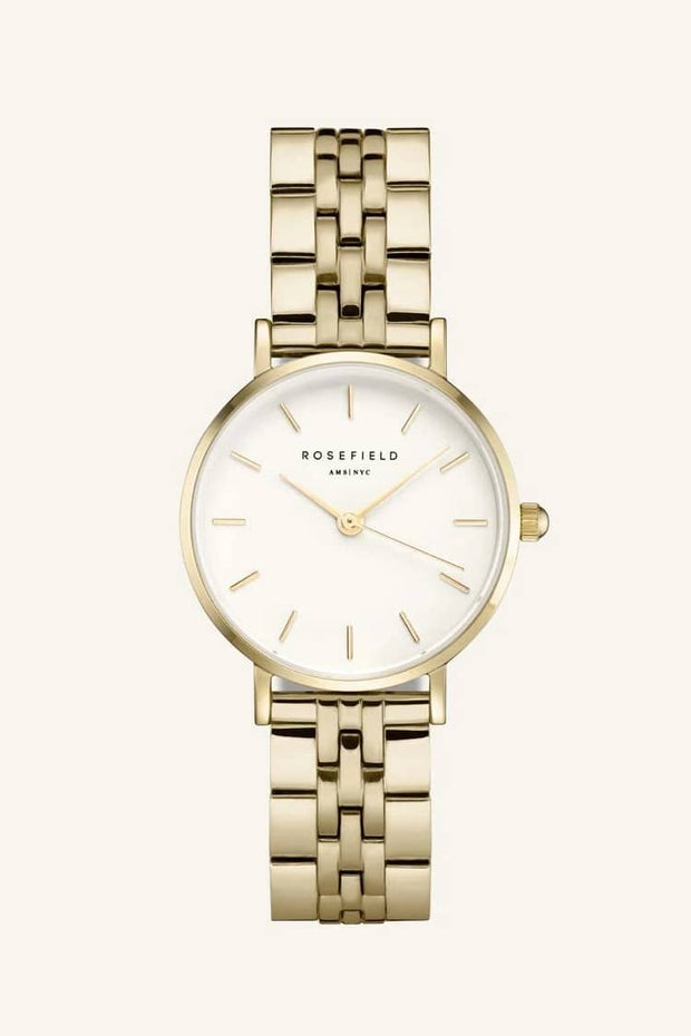 "ROSEFIELD SMALL EDIT - WHITE / GOLD LINKS  The Rosefield Small Edit Watch is a dainty watch perfect for every day wear. Simple sophistication! Featuring a gold link-style strap, which is easy to adjust, a white face, with gold hardware and signature 'Rosefield"" engraving, this beautiful watch is small with a big presence! The Rosefield Small Edit Watch can be interchanged with any of the other straps in the Small Edit collection."
