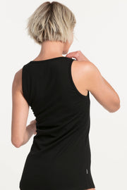 NES WOMENS MERINO LATTICE SINGLET - BLACK  The Nes Merino Lattice Singlet is a winter wardrobe essential. The Merino Lattice singlet speaks for itself and is crafted from Merino and features a scooping neckline with strap detailing which can be worn at either the front or back, finished with a high tank-like neckline at the back of the garment, which can be reversed for individual styling to create the perfect look!