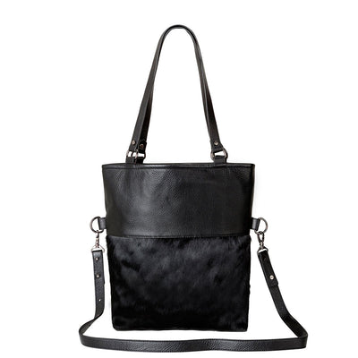 Status Anxiety Wasteland Bag - Black/Fur Womens Handbag / Premium Italian leathers / Large internal zipper, open pocket and iPhone stash / 37cm (tall) x 35cm (wide) x 10cm (thick at base) / Shoulder strap drop - 26cm. Long strap drop - 40cm / Comes in a Status Anxiety soft material drawstring bag