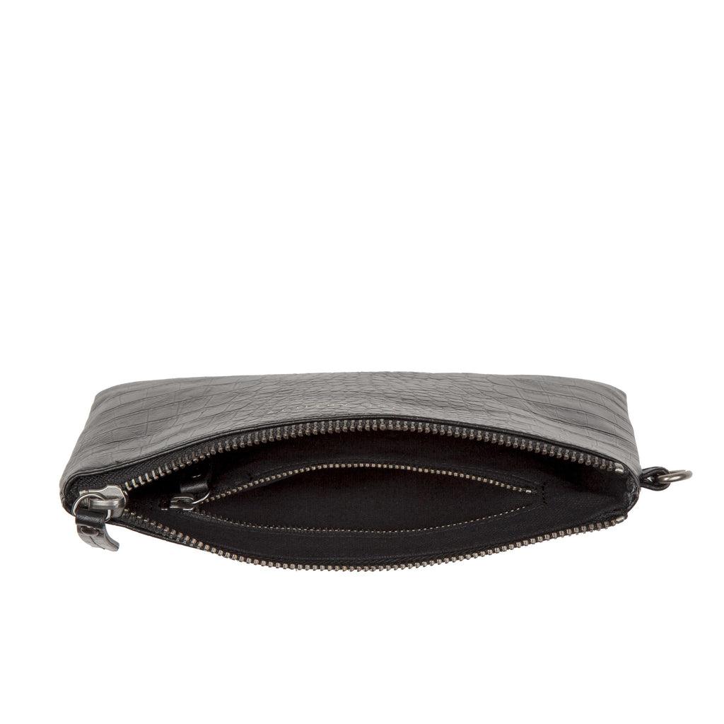 The Status Anxiety Fixation Wallet is the perfect edgy clutch, in a convenient size to hold all your daily essentials. It features a handy wrist strap, one inner zip pouch, and a trendy crocodile embossed design, crafted using full grain Italian leather. This clutch is great for daily use, or for a special occasion.