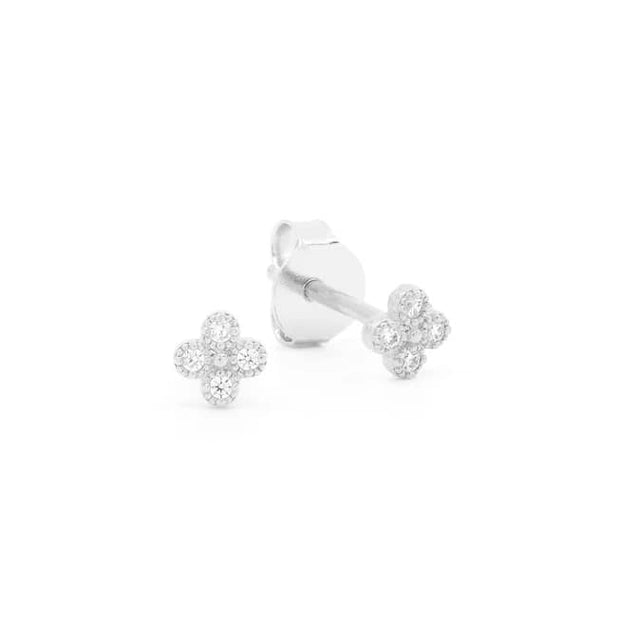 BY CHARLOTTE LUMINOUS EARRINGS  The By Charlotte Luminous Earrings are gorgeous feminine earrings, which can be worn to add some simple sophistication to any outfit. The Luminous Earrings feature an classic stud-style, with each suspending a dainty four leaf clover charm, which is sporting Cubic Zirconia crystals.