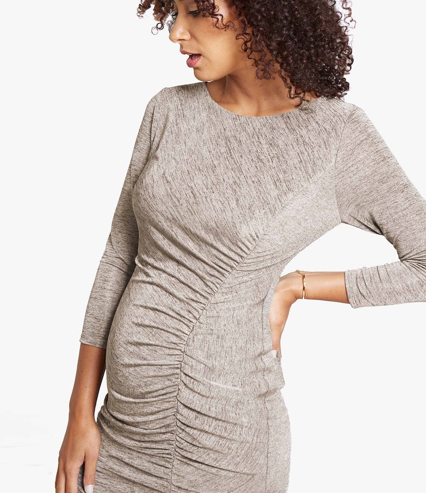 IN THE DETAILSSide ruching is insanely forgiving making this dress a cute and comfy go-to, three-quarter sleeves offer just the right amount of coverage, and a flattering front slit adds a flirty touch.