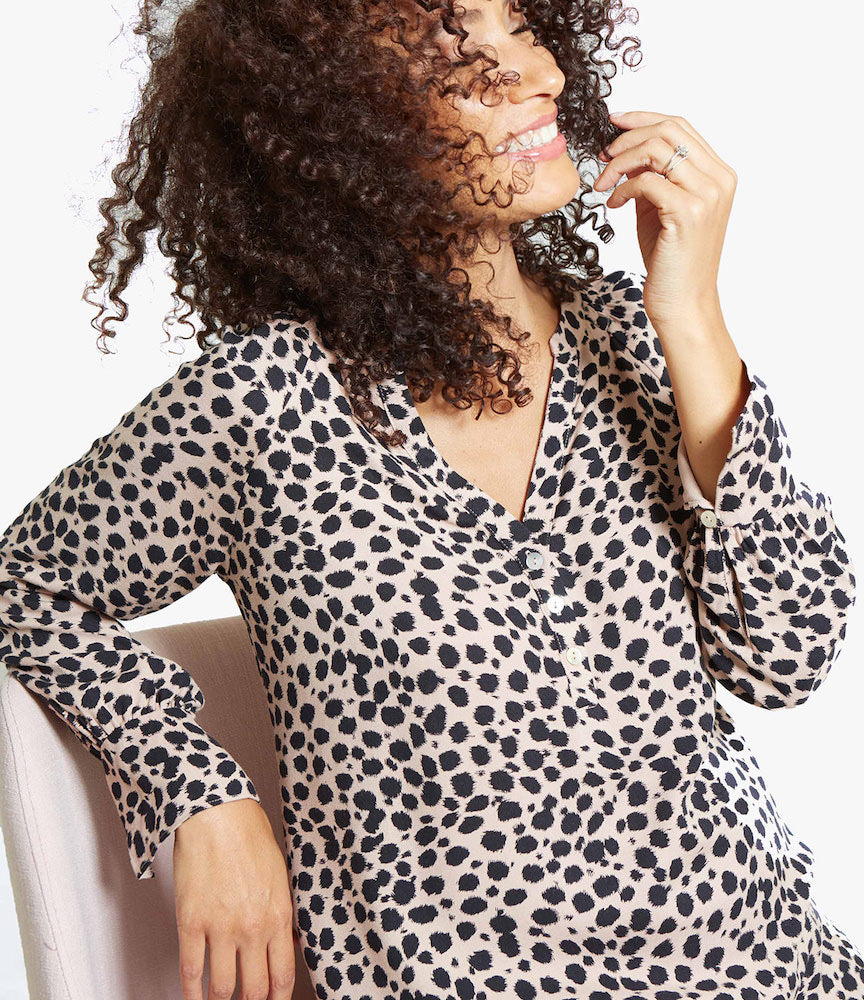 FASHION + FUNCTIONA split-neckline with three perfectly placed buttons make this cute top a nursing mama's dream—easy access for breastfeeding or pumping.