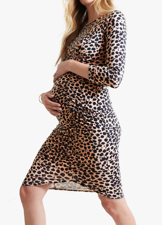 "Model is 5'9"", 6.5 months pregnant, and wears size S."