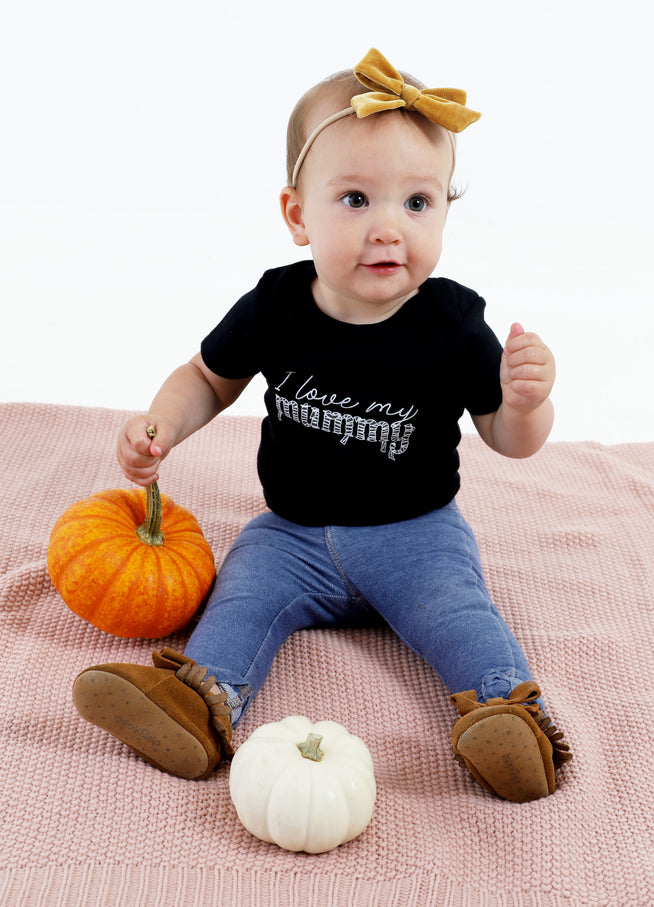 Model is 11 months old, wearing size 9-12.