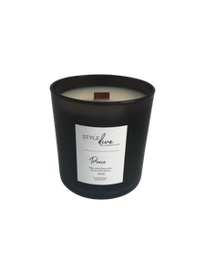 Black glass 9 oz soy blend with wood wick. Ocean, water lilies and freesia fragrance.