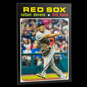 Rafael Devers 2020 Topps Heritage Action Variation SP where he's throwing the ball after Fielding a grounder. The ball is in mid air. Boston Redsox