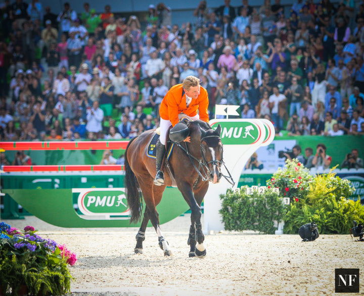 Jeroen Dubbledam with Rolf-Goran Bengtsson's mount Casall ASK, just after winning the 2014 World Championship.