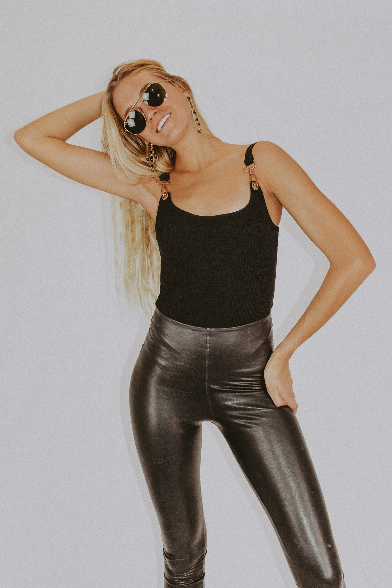 BUCKLE UP BODYSUIT IN BLACK