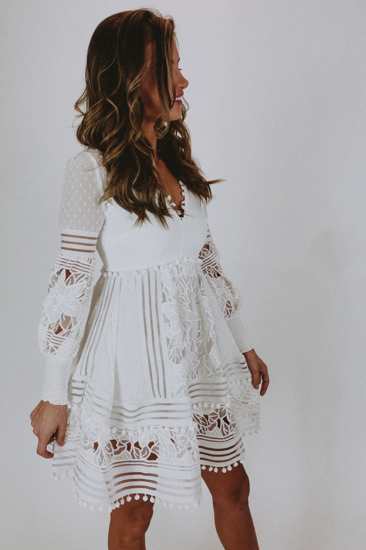 WHITE LONG SLEEVE POM POM DRESS