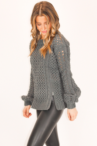 MOCK NECK OPEN BACK SWEATER IN BLACK