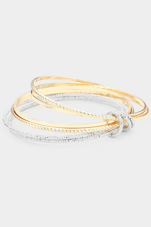 TEXTURED BANGLES IN GOLD AND SILVER