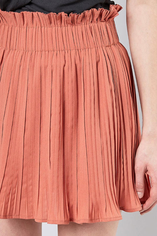 PLEATED SKIRT IN BAKED PEACH