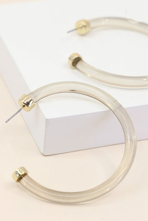 THIN LUCITE HOOPS IN CHAMPAGNE