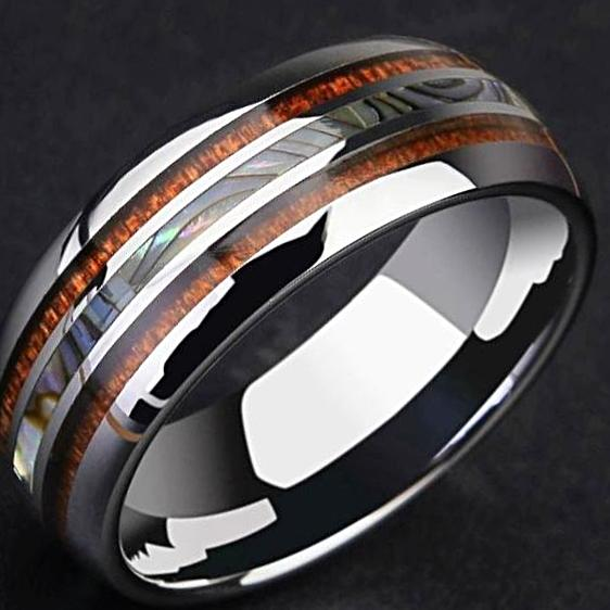 angle view of ring with mother of pearl glow shine on tungsten metal ring