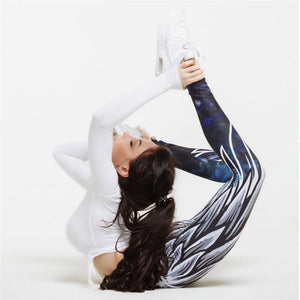 woman in angel wing leggings doing yoga stretch showing the material movement